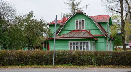 Old rural house with apple garden in St. Petersburg, Russia.