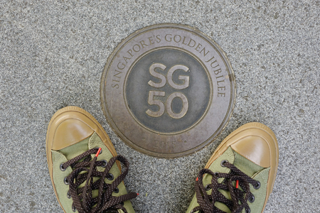 Singapore - Feb 9, 2018. Singapore 50th Anniversary (SG50) logo with shoes on road in downtown. The National Day of Singapore is celebrated every year on August 9. Editorial