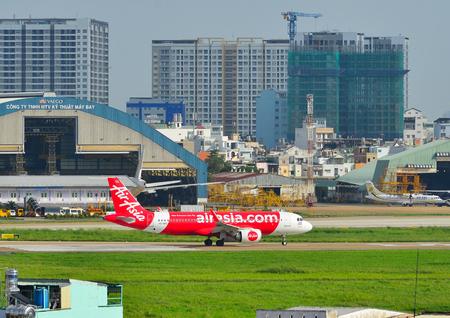Saigon, Vietnam - Jun 26, 2018. Passenger airplanes taxiing on runway at Tan Son Nhat Airport (SGN) in Saigon (Ho Chi Minh City), Vietnam.