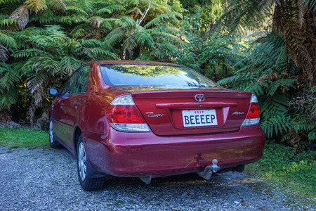 Haast, New Zealand - Apr 30, 2015. Private car Toyota Camry parking on street in Haast, New Zealand.