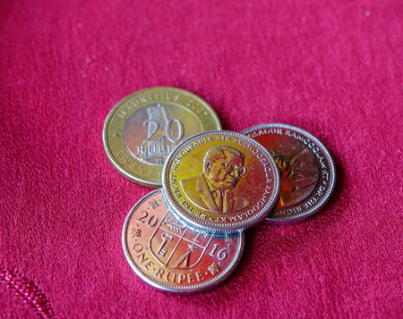 Mauritius Rupee (MUR) coins with red background - close up.