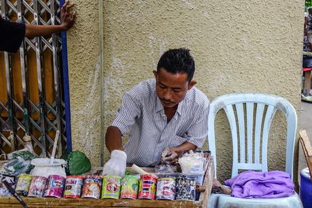 Yangon, Myanmar - Feb 1, 2017. Selling betel leaf at market in Yangon, Myanmar. Chewing betel nut is one of the most popular traditions in Myanmar.