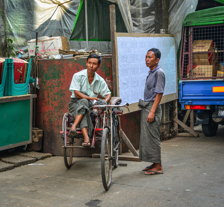 Yangon, Myanmar - Feb 1, 2017. Pedicab driver on street in Yangon, Myanmar. Yangon is Myanmar largest city and its most important commercial centre. Editorial