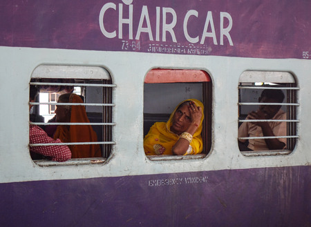 Varanasi, India - Nov 5, 2017. A local train stopping at railway station in Varanasi, India. Varanasi is the holiest of the seven sacred cities in Buddhism and Hinduism. Editorial
