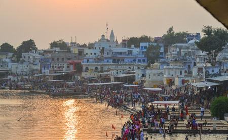 Pushkar, India - Nov 5, 2017. View of Pushkar lake and the town in sunset. Pushkar is a pilgrimage site for Hindus and Sikhs, located in state of Rajasthan. Redakční