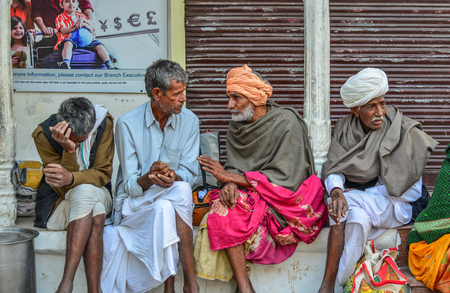 Pushkar, India - Nov 5, 2017. Local man relaxing on street in Pushkar, India. Pushkar is a pilgrimage site for Hindus and Sikhs, located in State of Rajasthan.
