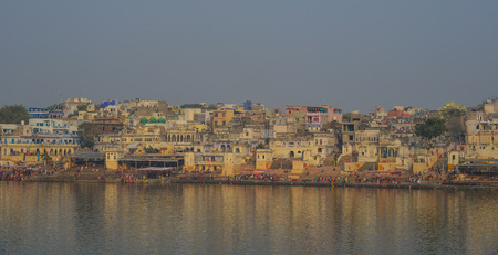 Pushkar, India - Nov 5, 2017. View of Pushkar lake and the town. Pushkar is a pilgrimage site for Hindus and Sikhs, located in the state of Rajasthan.