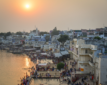 Pushkar, India - Nov 5, 2017. View of Pushkar lake and the town in sunset. Pushkar is a pilgrimage site for Hindus and Sikhs, located in state of Rajasthan. Editorial