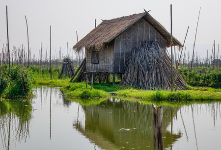 Wooden floating houses on Inle Lake, Myanmar. Inle Lake is a freshwater lake located in the Taunggyi District of Shan State. Banco de Imagens