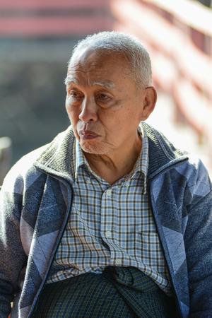 Inle, Myanmar - Feb 15, 2016. Portrair of old man at rural house on Inle Lake, Myanmar. Editorial