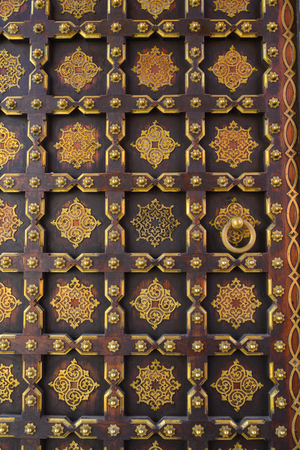 Texture on old wooden door of ancient palace in Jaipur, India. Editorial
