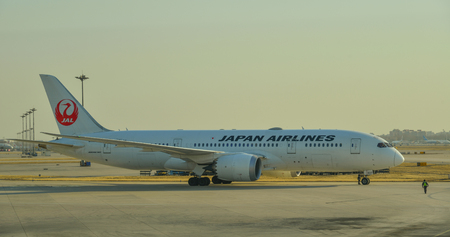 Beijing, China - Feb 28, 2018. A Boeing 787 Dreamliner airplane of Japan Airlines (JAL) taxiing on runway at Beijing Capital International Airport (PEK). Редакционное