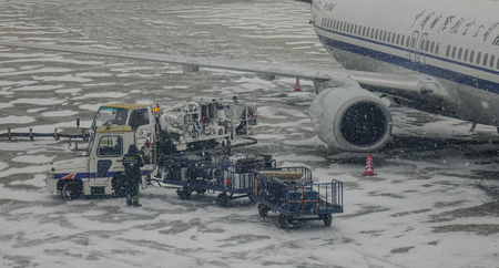 Harbin, China - Feb 28, 2018. Harbin Taiping International Airport in a snowing winter day. Taiping is the largest northernmost airport of China. Redactioneel