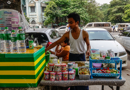 Yangon, Myanmar - Feb 26, 2016. Street vendor cart selling fruit juices in Yangon, Myanmar. Yangon is Myanmar largest city and its most important commercial centre. Editorial