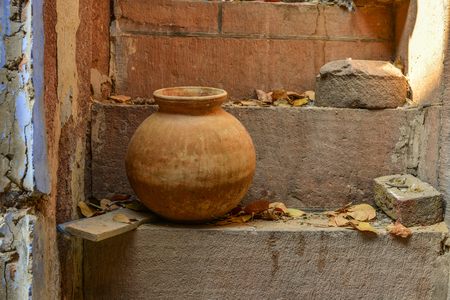 Old pottery pot on stairs at ancient town of Jaipur, India.