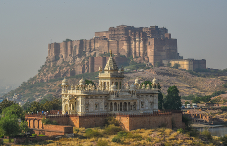 Mehrangarh Fort and Jaswant Thada in Jodhpur, India. The Jaswant Thada mausoleum is built out of intricately carved sheets of marble.