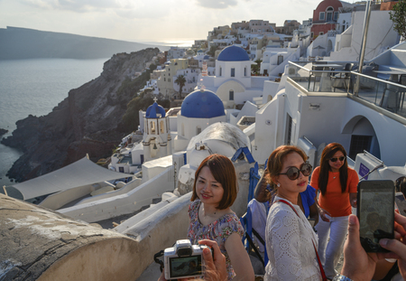 Santorini, Greece - Oct 9, 2018. Many tourists visit Santorini Island, Greece. Santorini is one of the most popular islands for destination weddings and honeymoons.