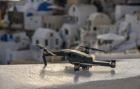 A drone with cityscape of Santorini (Greece) background.