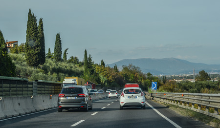 Rome, Italy - Oct 13, 2018. Vehicles run on highway in Rome, Italy. The total length of Autostrade (highway in Italy) is about 6,758 kilometres. Banco de Imagens - 118091454