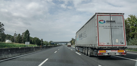 Rome, Italy - Oct 13, 2018. A heavy truck running on highway in Rome, Italy. The total length of Autostrade (highway in Italy) is about 6,758 kilometres.