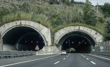 Rome, Italy - Oct 13, 2018. A four lane road passing through a tunnel in Rome, Italy. The total length of Autostrade (highway in Italy) is about 6,758 kilometres. 에디토리얼