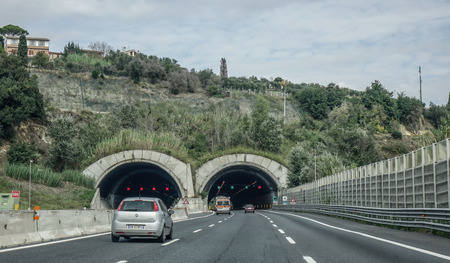 Rome, Italy - Oct 13, 2018. A four lane road passing through a tunnel in Rome, Italy. The total length of Autostrade (highway in Italy) is about 6,758 kilometres. Reklamní fotografie - 118091414