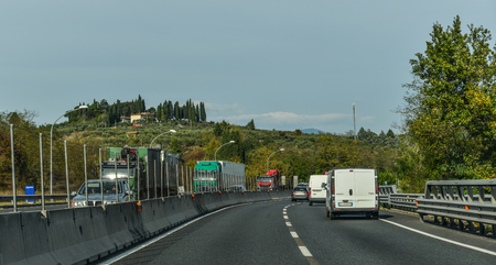 Rome, Italy - Oct 13, 2018. Vehicles run on highway in Rome, Italy. The total length of Autostrade (highway in Italy) is about 6,758 kilometres.