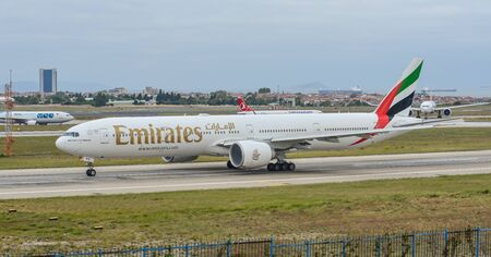 Istanbul, Turkey - Sep 30, 2018. A Boeing 777-300ER airplane of Emirates taxiing on runway of Istanbul Ataturk Airport (IST).