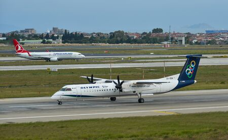 Istanbul, Turkey - Sep 30, 2018. A Bombardier Dash 8 Q400 airplane of Olypic Air taxiing on runway of Istanbul Ataturk Airport (IST).