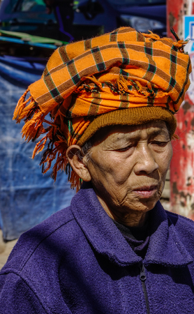 Taunggyi, Myanmar - Feb 8, 2018. Portrait of old woman in Taunggyi, Myanmar. Since 1962, Myanmar has become one of the poorest countries in the world. Redactioneel