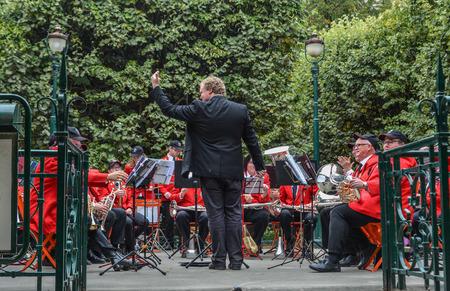 Paris, France - Oct 2, 2018. Conductor with musicians of Sydney Symphony Orchestra perform at public park near Notre-Dame de Paris.