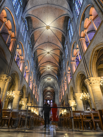 Paris, France - Oct 2, 2018. Interior of Notre-Dame de Paris. Cathedral is one of the finest examples of French Gothic architecture.