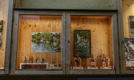 Hallstatt, Austria - Oct 15, 2018. Vintage window of souvenir shop in Hallstatt, Austria. Hallstatt is a charming lakeside village in the Alps.