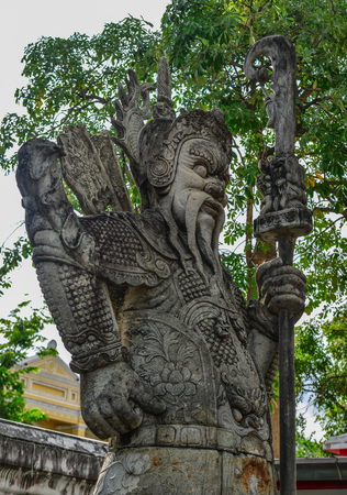 Chinese guardian figure beside a gate in Wat Pho. Wat Pho is one of the largest and oldest wats in Bangkok, Thailand.