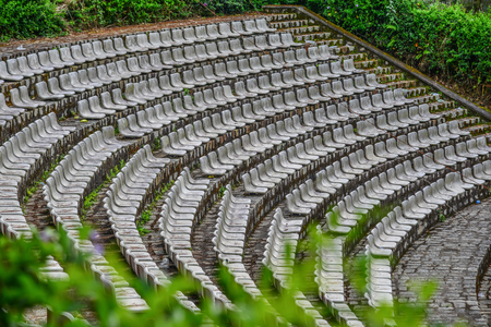 The grandstands of a modern outdoor amphitheater, a stage for small entertaining events, performances, concerts or presentations.