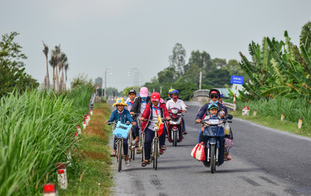 Can Tho, Vietnam - Nov 17, 2018. Highschool students going home by bicycle in Can Tho, Vietnam. Can Tho is the largest city in the Mekong Delta.
