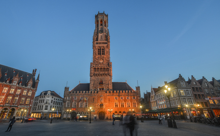 Bruges, Belgium - Oct 5, 2018. Night scene of Belfry Tower (Belfort) of Bruges. It is medieval bell tower in the historical centre of Bruges, Belgium.