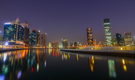Dubai, UAE - Dec 9, 2018. Night view of Dubai Marina with reflections in the harbour at blue hour. 写真素材 - 114944260
