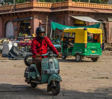 Jodhpur, India - Nov 6, 2017. A man riding Vespa on street in Jodhpur, India. Jodhpur is the second largest city in state of Rajasthan.