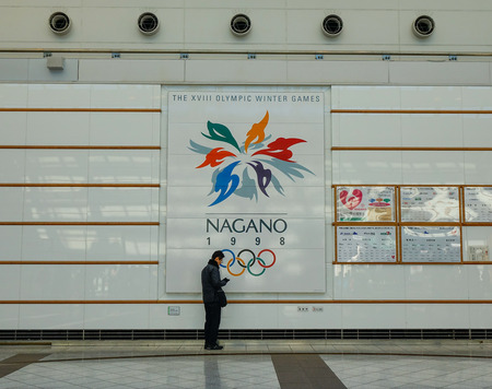 Nagano, Japan - Dec 30, 2015. Billboard of Olympic Winter Games XVIII 1998 at railway station in Nagano, Japan. Editorial