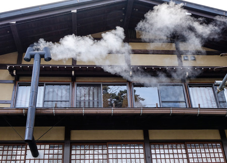 Smoke from the chimney of the old wooden house in Takayama, Japan.