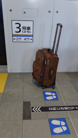 Takayama, Japan - Dec 30, 2015. A valise at platform of JR Shinkansen Station in Takayama, Japan.