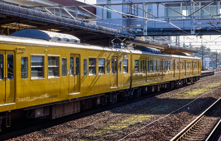 Hiroshima, Japan - Dec 3, 2016. Train stopping at railway station in Hiroshima, Japan. Trains are a very convenient way for visitors to travel around Japan. Редакционное