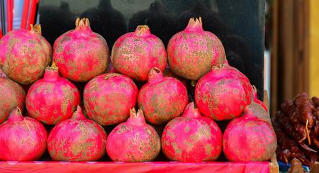 Several pomegranates in basket on the street for juice making in Mtskheta, Georgia.
