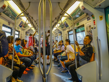 Bangkok, Thailand - Dec 25, 2018. People sitting on BTS train in Bangkok, Thailand. Traffic has been the main source of air pollution in Bangkok.