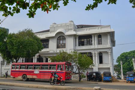Galle, Sri Lanka - Dec 22, 2018. Local bus running on street in Galle, Sri Lanka. Buses are the most widespread public transport type in Sri Lanka.