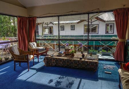 Nuwara Eliya, Sri Lanka - Dec 16, 2018. Living room with sunny light at old apartment. Nuwara Eliya is a city in the tea country hills of central Sri Lanka.