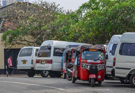 Colombo, Sri Lanka - Dec 12, 2018. Tuk tuk taxi on street of Colombo, Sri Lanka. Colombo is the financial centre of the island and a popular tourist destination.