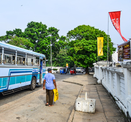 Galle, Sri Lanka - Dec 22, 2018. People walking on street in Galle, Sri Lanka. Buses are the most widespread public transport type in Sri Lanka.