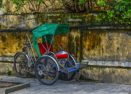 Cyclo (rickshaw) on street in Hoi An, Vietnam. Hoi An is one of popular tourist destinations in Asia.